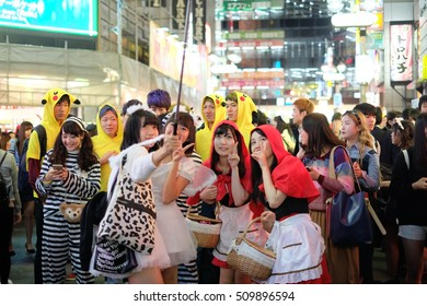 TOKYO - OCTOBER 31 2016 : Shibuya crossing area is crowded with people wearing Halloween costumes and makeup, on October 31, 2016 in Tokyo.
