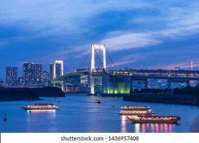 TOKYO ODAIBA LANDSCAPE WITH RAINBOW BRIDGE AND HOUSEBOATS