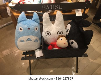 Tokyo, Tokyo Prefecture/Japan - August 19, 2018: Various stuffed anime from Miyazaki movies sit on a bench together