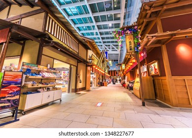 TOKYO - SEPTEMBER 1, 2015: Haneda airport at the Edo Market Place. The shops sell tourists goods from Edo era recreation buildings inside the terminal.