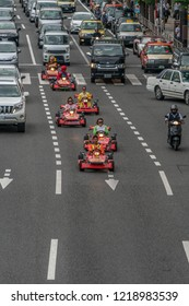 Tokyo, Shinagawa Ward - August 16, 2018 - Mario Karts go-karts whizzing through traffic in Shinagawa drivers wearing Mario Character costume now banned by Nintendo