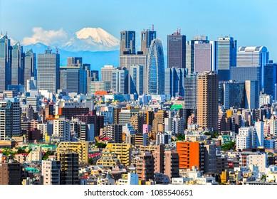 Tokyo, Shinjuku building cityscape and Mt. Fuji at Behind.