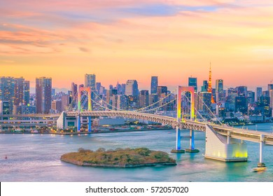 Tokyo skyline with Tokyo tower and rainbow bridge at sunset in Japan