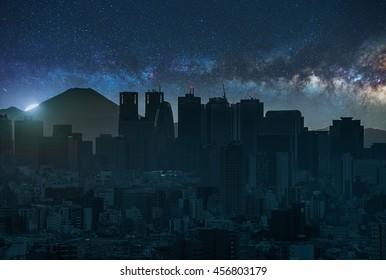 Tokyo skyline under the milky way (composite image).