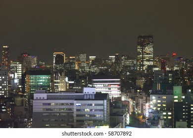 Tokyo skyscrapers at night from high above. All trademarks and sign boards are blurred or erased.