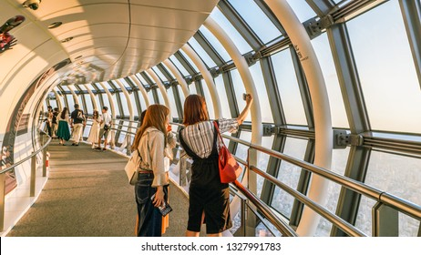Tokyo Skytree, Sumida, Tokyo / Japan - May 24, 2018: People admiring Tokyo Skytree and the view of Tokyo city before sunset time.