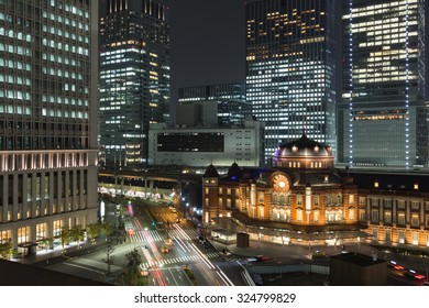 Tokyo station and cityscape with skyscrapers at night