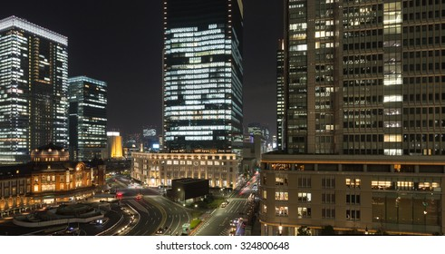 Tokyo station and cityscape with tall office buildings at night