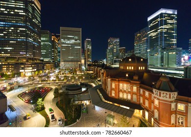 Tokyo Station at night among high-rise buildings
