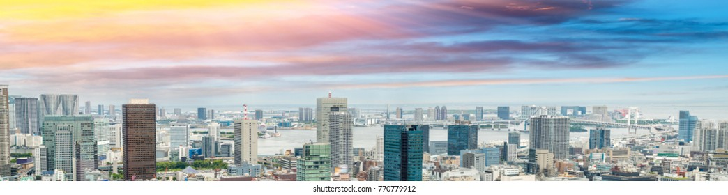 Tokyo stunning panoramic aerial skyline at sunset with Odaiba in background.