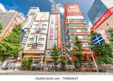 Tokyo, Taito-Ku, Akihabara - August 13, 2017 : Motion blurred people walking along shops and Colorful Billboard Advertisements at Akihabara Electric Town