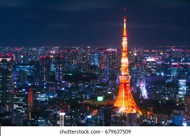 Tokyo Tower, Tokyo among skyscrapers at Night
