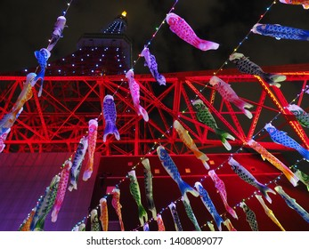 Tokyo tower and flying carp.Carp streamer is traditional event in japan.
