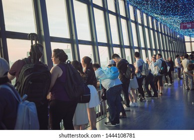 TOKYO TOWER, TOKYO, JAPAN - June 24 2018: Tourists at the Tokyo Tower observing the Tokyo cityscape.