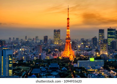 Tokyo tower light up at dusk with twilight sky before sunset, Japan. Arial skyline cityscape view of famous landmark.