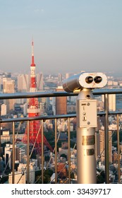 The Tokyo Tower seen from a tourist viewpoint on Roppongi Hills Observation Deck.