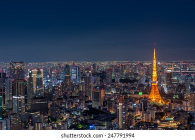 Tokyo Tower stands out among the Tokyo cityscape as dusk falls over Japan.