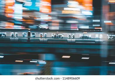 Tokyo Train Rushing Through City