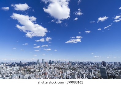 Tokyo urban landscape Overall view White clouds flowing in the blue sky