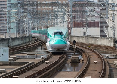 "TOKYO-April 14,2016:The green E5 Series bullet (High-speed) train. It services as ""Hayabusa(Falcon) or Hayate"" operated by JR East and JR Hokkaido for Tohoku and Hokkaido Shinkansen.(Tokyo - Hakodate)"