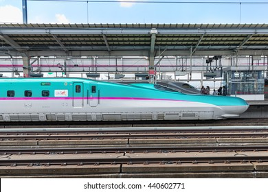 "TOKYO-April 15,2016:Side view of the green E5 Series bullet(High-speed) train. It services as ""Hayabusa(Falcon) or Hayate"" operated by JR East and JR Hokkaido for Tohoku and Hokkaido Shinkansen lines."