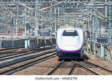 "TOKYO-April 15,2016:The E2 Series bullet (High-speed or Shinkansen) train. It almost services as ""Yamabiko"" operated by JR East for Tohoku Shinkansen lines. (Tokyo - Morioka route)"