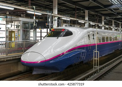 "TOKYO-April 19,2016 : The E2 Series bullet (High-speed or Shinkansen) train. This train services as ""Yamabiko"" operated by JR East for Tohoku Shinkansen lines. (Tokyo - Morioka route)"