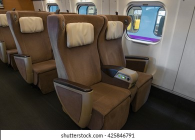 "TOKYO-April 19,2016: Green seats of E5 Series bullet(High-speed,Shinkansen) train. This Shinkansen train service as ""Hayabusa or Hayate"" operated by JR East/Hokkaido for Tohoku/Hokkaido Shinkansen."