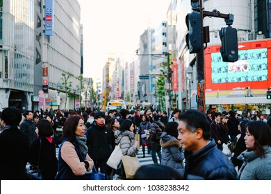 Tokyo/Japan - 6.01.2018: City advertising and Japanese people