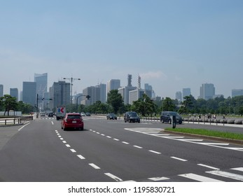 """Tokyo/Japan - August 11 2018: Uchibori-dori avenue in Chiyoda, Tokyo. Chiyoda (lit. """"Thousand Generations Rice Field"""") is a special ward located in central Tokyo, Japan."""