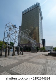 Tokyo/Japan - August 4 2018: Asahi Breweries Headquarter and Asahi Beer Hall with its distinctive gold Flamme d`Or icon designed by architect Philippe Starck in Asakusa.