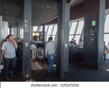 Tokyo/Japan - August 4 2018: People inside the Tokyo Skytree tower. Tokyo Skytree is a broadcasting, restaurant and observation tower in Sumida, Tokyo, Japan.