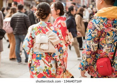 TOKYO,JAPAN - February 20, 2019 : People are wearing kimono while travel in Senso-ji Temple , famous temple in Tokyo,Japan.
