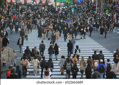 Tokyo/Japan- January 14 2018: japanese cross the road on Shibuya street. Shibuya is one of the famous business area in Tokyo.