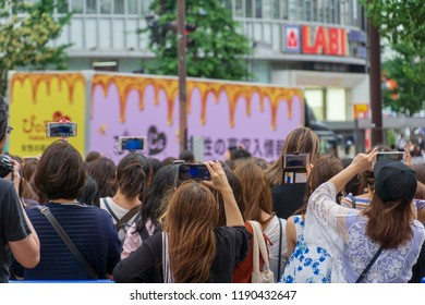 Tokyo,Japan. July 4, 2018.back view,crowd or group of young asian female watching concert or protesting against government in the public area in the city