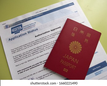 Tokyo/Japan - March 22, 2018 - Japanese Passport and ESTA application status printed on paper. Authorization Approved.