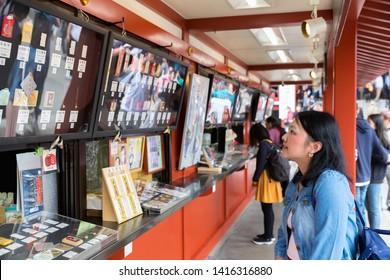 TOKYO,JAPAN - MAY 12,2019 : Tourist shoping Japanese Name Plate or amulet and talisman is a souvenir that can find at Nakamise Dori Shopping Street at Sensoji Temple Asakusa