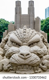 Tokyo/Japan-09/03/2015: Godzilla/Gojira and Metropolitan Government Building sand statue in a park in the city centre