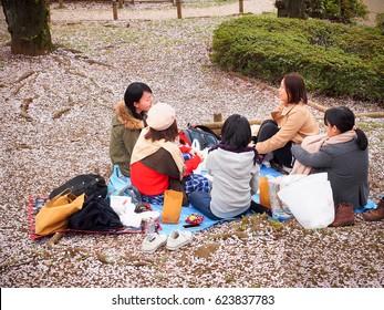 Tokyo,Japan-April 09,2017, Japanese women having a picnic or hanami in sakura or cherry blossom festival.