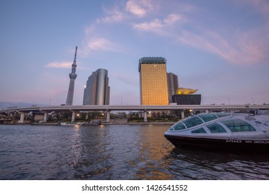 Tokyo,Japan,April 18 ,2019 : View of Sumida River with Tokyo Skytree and The Asahi Beer building in Tokyo , Japan. Asakusa is a landmark of old town popular tourist spot.
