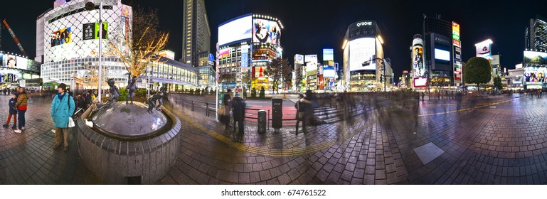 TOKYO,JAPAN-APRIL 25:Shibuya Crossing at night with long exposure 360 degrees panorama photography(create moving of people)in Tokyo city on April 25, 2014.This Crossing is important area of Tokyo city