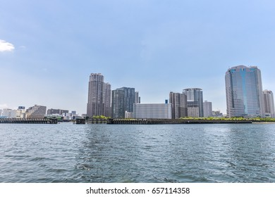 TOKYO,JAPAN-Jun 26,2016 : Skyscrapers at  Tsukudajima with wooden walkway to the river.