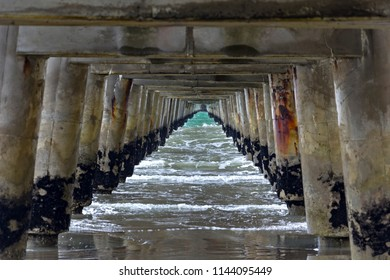 Tolaga Bay Wharf, a historic pier in the Pacific Ocean, Gisborne, New Zealand. The last cargo ship to use the wharf loaded a cargo of maize in 1967