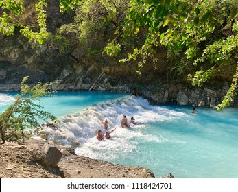 TOLANTONGO, MEXICO - May 30, 2018: People bathing in the blue waters of the Tolantongo river in the Mezquital Valley, State of Hidalgo, Mexico.