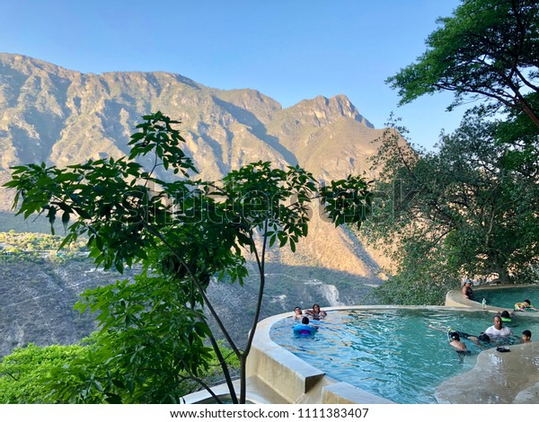 Tolantongo, Mexico - May 30, 2018: People swimming and relaxing in heated pools and hot springs of Tolantongo near the bottom of a steep box canyon in Mezquital Valley in State of Hidalgo, Mexico.
