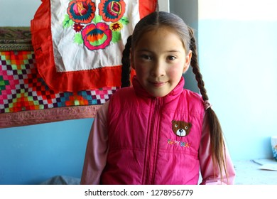 TOLBO, BAYAN-OLGII PROVINCE, MONGOLIA - OCTOBER 04, 2018: Portrait of little children living and education in boarding school.