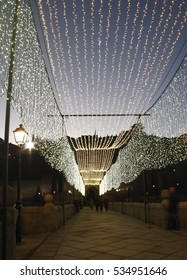 Toledo illuminated, Spain, Lighting of the Christmas holidays on the bridge of Alcántara, of Roman and Arab origin, that crosses the River Tagus,