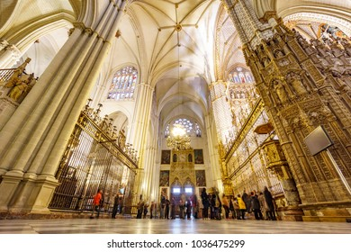 TOLEDO - MARCH 17: Unidentified huge group of tourist taking photos to Toledo cathedral on March 17 2015 Toledo, Spain. Toledo cathedral is built in Gothic architecture