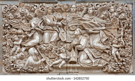 TOLEDO - MARCH 8 Baroque relief from portal of church Iglesia de san Idefonso on March 8, 2013 in Toledo, Spain.