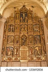 TOLEDO - MARCH 8: Polychrome main altar of San Roman church has a steeple built in the mudejar architectural style in the 13th cent. on March 8, 2013 in Toledo, Spain.